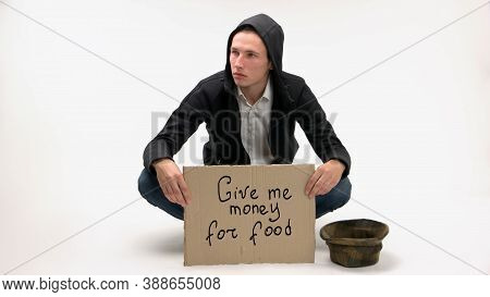 Give Me Money For Food On Cardboard Sign. Jobless Young Man Begging For Money For Food Isolated On W