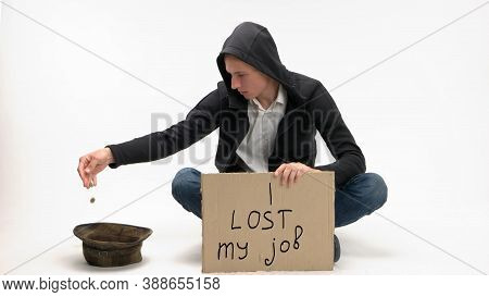 Young Jobless Man Dumps Donations In His Hat. Isolated On White. I Lost My Job.