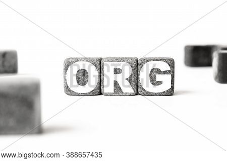 Three Stone Cubes Inscribed With The Word Org Among The Cubes On A White Background. Strong Business