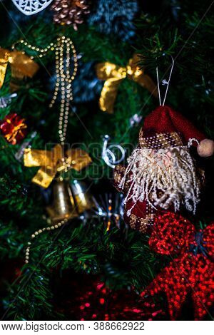 Christmas Hanging Decorations On Fir Tree. Decorated Christmas Tree. Fir Branch With Christmas Baubl