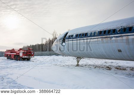 Airfield Firetruck And Aircraft After Emergency Landing In A Cold Winter Airport