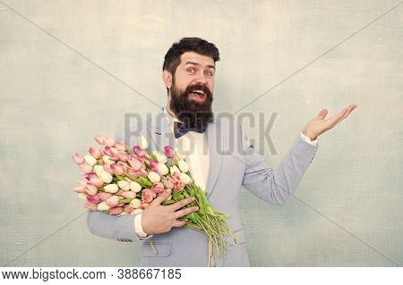 Shop Now. Happy Hipster With Tulips. Bearded Man With Spring Flowers. Flowering Present. Floral Pres