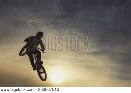 Unrecognizable Biker Performing Acrobatic Jump At Sunny Sky - Guy Riding Bmx Bicycle At Extreme Spor