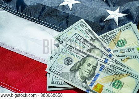 American Dollars Banknotes On The Flag Of United States Of America. Us Dollars Background. 100 Usd