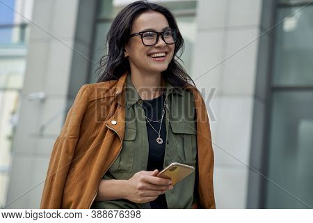 Being Outside On A Beautiful Day. Young Happy Fashionable Woman Wearing Eyeglasses Walking On The Ci