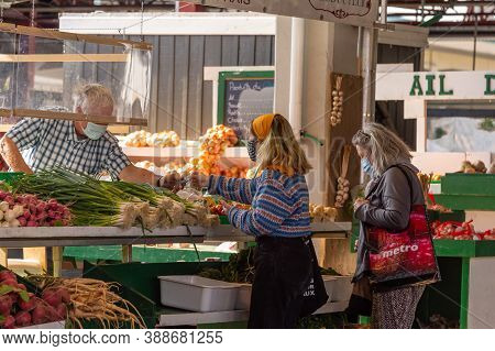 Montreal, Ca - 4 October 2020: Customers Wearing Coronavirus Face Masks At Marche Jean Talon Market
