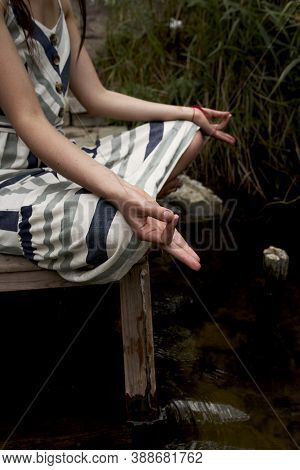 Beautiful Young Woman In Dress Meditating On The Nature. Summertime, Mind Detox And Yoga Concept