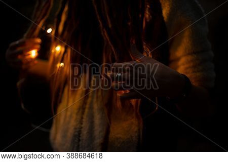 Unfocused Pagan Gothic Style Photography With Woman Hand And Ring On Finger In Fire Illumination Lig