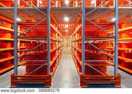 Territory Of Warehouse Logistics. The Interior Of A Large Goods Warehouse With Shelves Of Pallet Rac