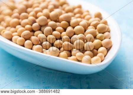 Bowl of dried soy beans, popular food ingredient