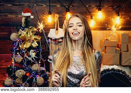 Sparkles Party, Bengal Lights. Christmas Interior. Funny Christmas Girl. Winter Holidays And People