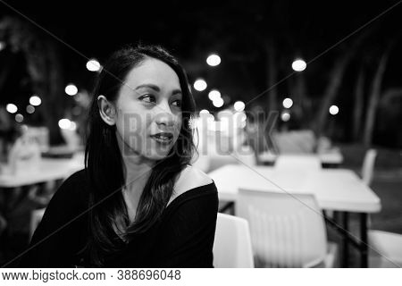 Close Up Of Young Beautiful Asian Woman Thinking While Looking At Distance In The Night Market At Hu