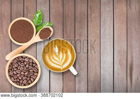 Coffee Beans Roasted In Wooden Bowl, Fresh Coffee Powder In Bowl And In Wooden Spoon, Coffee Leaves,