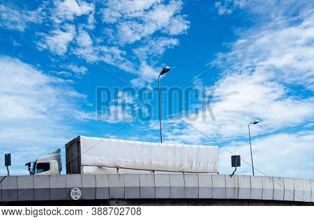 Truck Transport Logistics. Elevated Concrete Highway Road. Truck With Containers On The Road Deliver