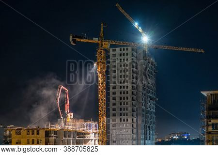 Night Pouring Of The Monolith At A Construction Site. Night Work At A Construction Site In The City.