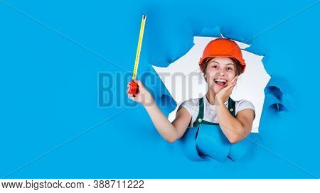 Kid Builder Wear Helmet. Teen Girl In Hard Hat And Uniform. Building And Construction. Concept Of Re