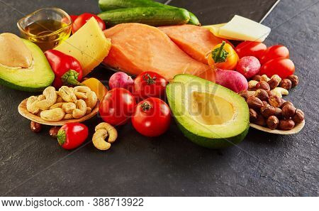 Ketogenic Diet Concept. Low Carb Keto Diet Food Set. Green Vegetables, Nuts, Fish Fillets, Cherry To