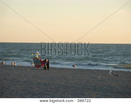 Female In Beach Chair At Sunset