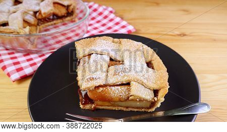 Slice Of Delectable Homemade Fresh Apple Pie Served On Wooden Table