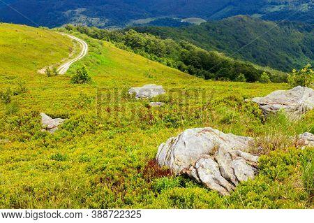 Rocks On The Hillside. Summer Mountain Landscape On Carpathians On A Cloudy Day