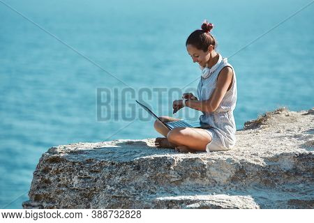 Female Read Message On Smart Watch. Work On Summer Trip. Ocean View And Virgin Nature. Remote Office