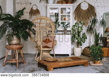 Cozy Room With Interior Design In Boho Chic Style Pillow At Wicker Armchair, Small Coffee Table, Com