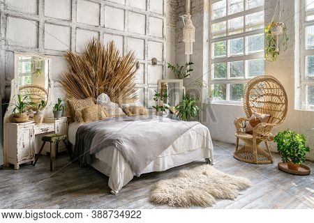 Side View Of Authentic Cozy Bedroom With Interior Design In Boho Chic Style, Decorative Headboard Ov
