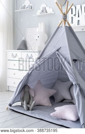 Vertical View Of Childrens Play Room With Comfort, Soft Pillows In Tent, White Wooden Dresser, Rabbi