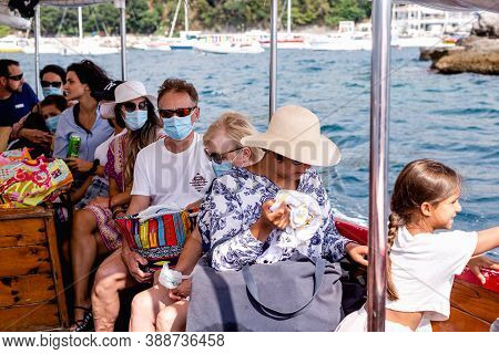 19.9.2020 Herceg Novi, Montenegro. People Traveling By Boat In Vacation. People Travel With Protecti