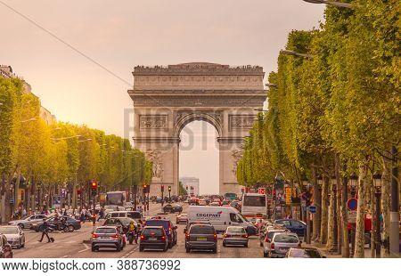 Paris, France - 9 September, 2012: The Champs-Élysées And The Arc De Triomphe. The Most Famous Avenu