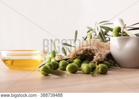 Preparation Of Olive Oil Seed In Ceramic Glass For Body And Culinary Care On Table With Mortar And S