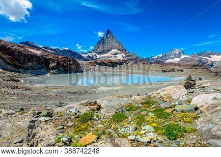 Alpine Meadows Around Matterhorn Peak Or Mount Cervin O Monte Cervino And Swiss Alps Reflected In Gl