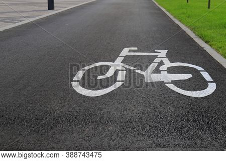 White Drawn Bike Sign On The Asphalt. Separate Cycle Path For Cyclists, Environmentally Friendly Urb