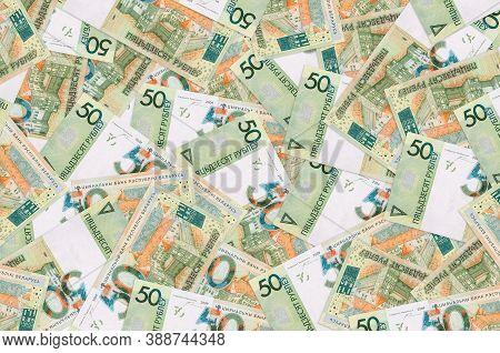 50 Belorussian Rubles Bills Lies In Big Pile. Rich Life Conceptual Background