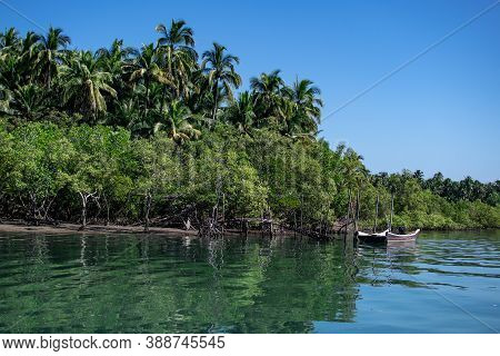 Two Boats In The Calm Turquoise River With Mangrove Trees And Clear Sky, Peace And Quiet, Ngwesaung,