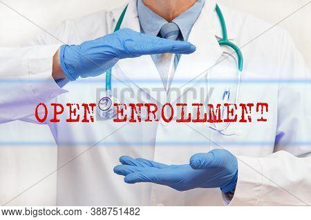 Doctor's Hands With Open Enrollment Inscription. Medical Concept