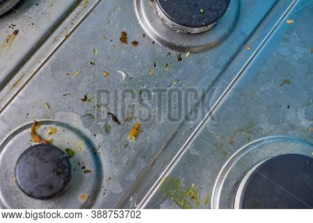 Dirty Stove Top With Oil Splatters, Fat Stains And Food Leftovers. Unclean Steel Kitchen Cooktop Wit