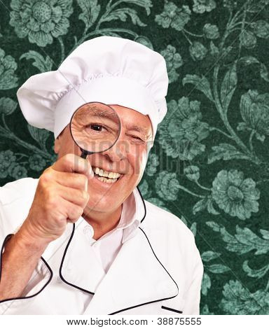 Portrait Of A Chef Holding Magnifying Glass, Indoor
