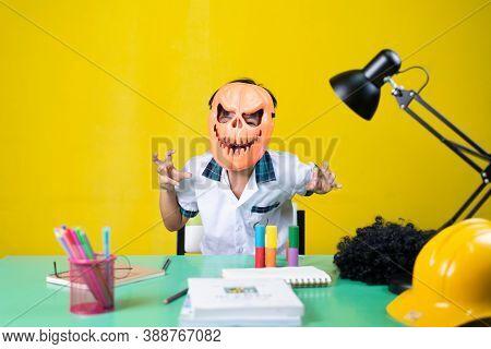 Child Wearing A Devil Mask, Have Fun, Homework Desk.