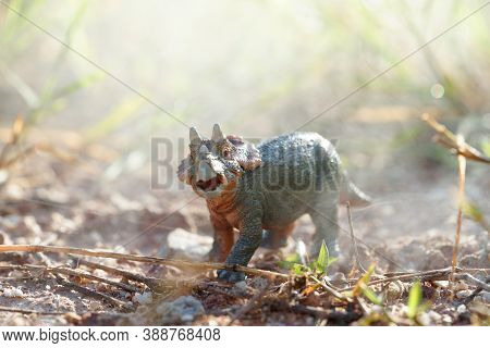 Triceratop With Baby In A Misty Forest. On Nature Background. Closeup Dinosaur And Monster Model. Th