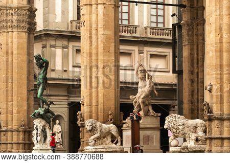 Sculpture Of Loggia Dei Lanzi And Florence Palazzo Vecchio On Piazza Della Signoria In Florence, Ita