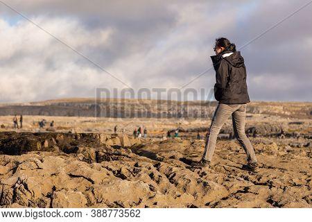 Atlantic Ocean Coast, Ireland- 07 November 2015: People On A Rock On The North Coast Of The Atlantic