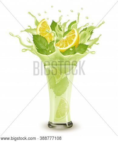 Fresh Fruit Drink Splash. Whole And Sliced Limon And Green Mint  In A Fresh Juice Or Cocktail With S