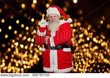 Santa Clause Raised Index Finger. Bearded Concentrated Santa Claus Pointing With Index Finger Upward