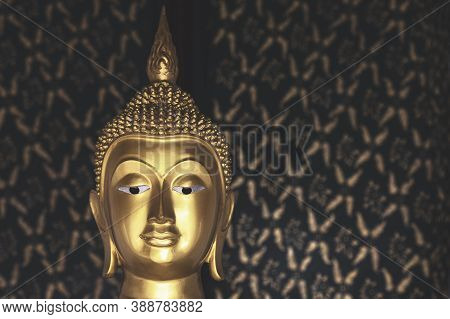 Golden Buddha Statue With Sunlight Used For Amulets Of Buddhism Religion. Buddhism Is Popular Region
