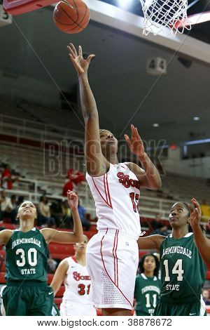 NEW YORK-NOV 3: St. John's Red Storm center Jennifer Blanding (15) goes up for a basket against the Farmingdale Rams at Carnesecca Arena on November 3, 2012 in Jamaica, Queens, New York.