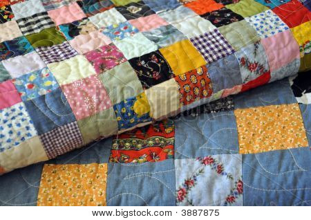 Close Up Of Handmade Quilt Stack