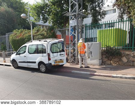 Holon, Israel. July 28, 2020. Bezeq Phone Company Technician Making A Test At The Service Connection