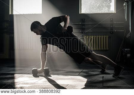 Strong Man Do Push Ups With Dumbbell .