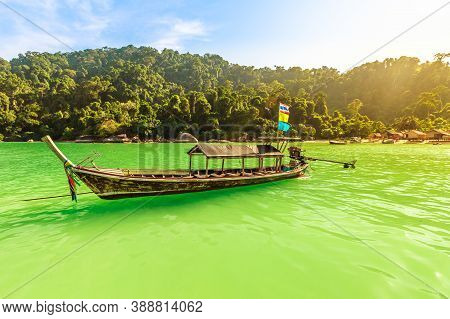 Traditional Thai Long-tail Boats With Diesel And Houses Of Moken Tribe Village Or Sea Gypsies And Tr